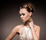 Portrait of a young woman in makeup and jewelry Royalty Free Stock Image