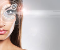 Portrait of a young woman in makeup with a laser on her eye Royalty Free Stock Images
