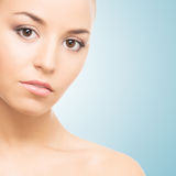 Portrait of a young woman in makeup on light blue Royalty Free Stock Photos