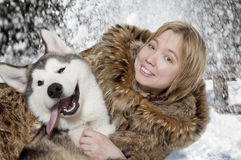 Portrait of young woman with malamute Royalty Free Stock Photo