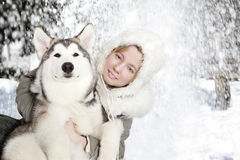 Portrait of young woman with malamute puppy Royalty Free Stock Photography