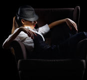 Portrait of young woman in manly style on chair Royalty Free Stock Images