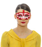 Portrait of a Young Woman with a Mask. Portrait of a young woman with a Colombina Venetian mask isolated against a white background Royalty Free Stock Photos