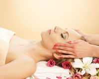 Portrait of a young woman on a massage procedure Royalty Free Stock Images
