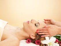 Portrait of a young woman on a massage procedure Royalty Free Stock Photo