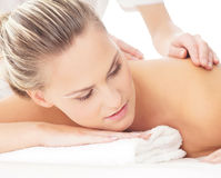 Portrait of a young woman on a massage procedure Stock Images