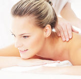 Portrait of a young woman on a massage procedure Stock Photos