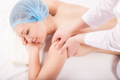 Portrait of young woman during massage procedure Stock Photography