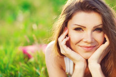 Portrait  young woman on the meadow on a warm summer day Stock Photography
