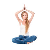Portrait of young woman meditating in pose of lotus isolated on white. Long haired blonde girl doing yoga. Royalty Free Stock Images
