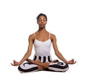 Portrait of young woman meditating in pose of lotus Stock Images