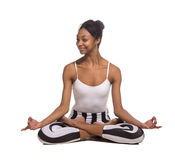 Portrait of young woman meditating in pose of lotus. In isolation Royalty Free Stock Photography