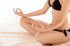 Portrait of young woman meditating in pose of lotus Stock Photos