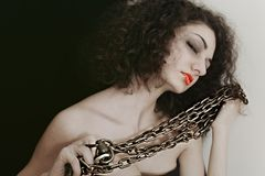 Portrait of a young woman with a metal chain Royalty Free Stock Photography