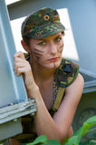 Portrait of young woman in military camouflage Stock Photo