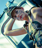 Portrait of young woman in military camouflage Royalty Free Stock Photo