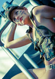 Portrait of young woman in military camouflage Royalty Free Stock Photography