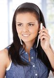 Portrait of young woman on mobile smiling Royalty Free Stock Photo