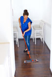 Portrait Of Young Woman Mopping Floor At Home . Cleaning Sevice.  Stock Photography