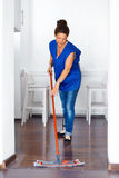 Portrait Of Young Woman Mopping Floor At Home . Cleaning Sevice.  Royalty Free Stock Photo