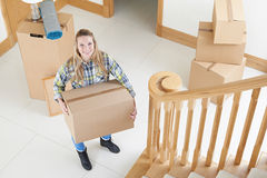 Portrait Of Young Woman Moving Into New Home Royalty Free Stock Photography
