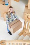 Portrait Of Young Woman Moving Into New Home Stock Image