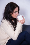 Portrait of young woman with mug of tea or coffee Stock Images