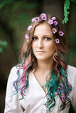 Portrait of a young woman with multicolored hair Royalty Free Stock Image