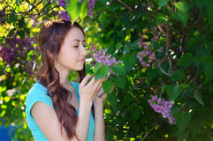 Portrait of young woman near  the blossoming  lilac Royalty Free Stock Image