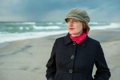 Portrait of a young woman near the sea in the header Royalty Free Stock Photo