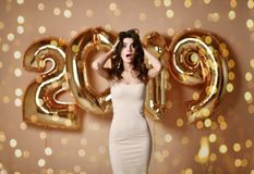 Portrait of a young woman in nude dress s Under boke Having Fun With Gold 2019 Balloon royalty free stock image