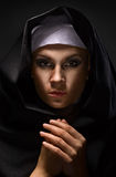 Portrait of a young woman nun. In hood stock photography