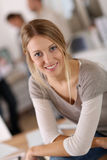 Portrait of young woman at office Stock Photos