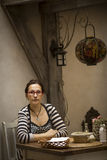 Portrait of a young woman in an old cafe. Suspense. Royalty Free Stock Photos