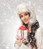 Portrait of a young woman opening a Christmas present Stock Image