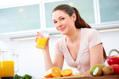 Portrait of young woman with orange Juice Royalty Free Stock Photos