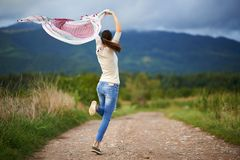 Portrait of a young woman outdoor dancing Royalty Free Stock Photography