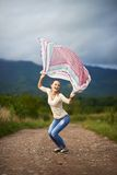 Portrait of a young woman outdoor dancing Stock Image