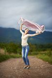 Portrait of a young woman outdoor dancing Stock Photography