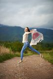 Portrait of a young woman outdoor dancing Stock Photos