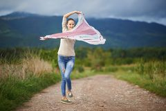 Portrait of a young woman outdoor dancing Royalty Free Stock Images