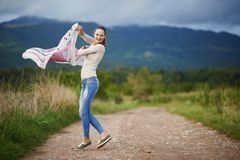 Portrait of a young woman outdoor dancing Royalty Free Stock Image
