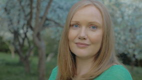 Portrait of young woman outdoor featuring natural stock footage