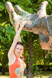 Portrait of young woman outdoor with statue. 's hands Royalty Free Stock Photography