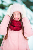 Portrait of young woman outdoors on beautiful winter snow day Royalty Free Stock Photo