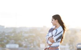 Young woman outdoors on city background in sunny day Royalty Free Stock Photography