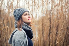 Portrait of young woman outdoors with reeds in the background stock photo