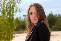Portrait of a young woman outdoors. With flying hair Royalty Free Stock Image