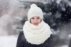 Portrait of a young  woman outdoors under snovfall. Royalty Free Stock Photo