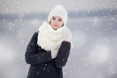 Portrait of a young woman outdoors under snovfall. Royalty Free Stock Photos